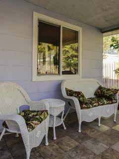 Covered tile porch with Weber gas grill