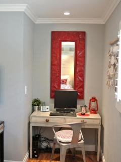 Stylish desk with computer in master bedroom + printer is inside the closet