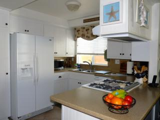 Cook in our recently remodeled Kitchen, w/Corian Countertops. And pots and pans and dishes galore!