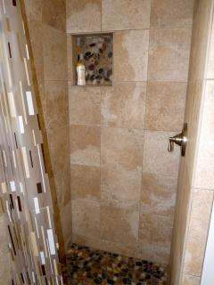 Shower off the sand in our new Laundry Room Tile Shower, under a nice hot shower