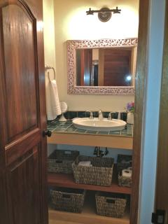 The 2nd bath is the size and design as the master bath and is located just off of the living room