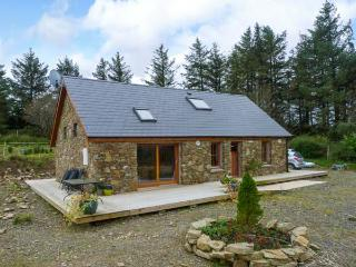 BALLYDUFF, detached cottage, with off road parking, dog friendly, decked area