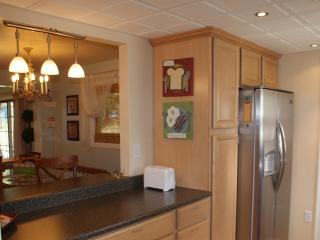 Kitchen opens to Dining Room with a Breakfast Bar