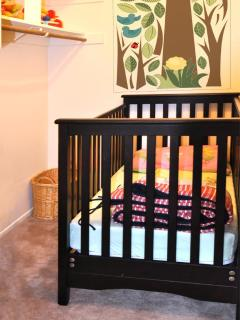 real wooden crib next to the master bedroom, another pack and play also available in the garage