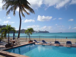 Beautiful view of pool, beach, and ocean.