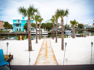 Beach Home 90Ft Dock on Bay! 3Br/2Ba, Large Deck, Palms, Jetski Dock