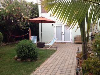 Relax in the colorful hammock or sip a frosty beverage in the shade of the patio umbrella
