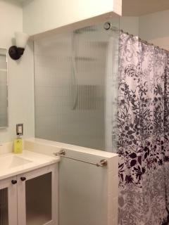 2-person shower with dual showerheads.  Tons of storage space