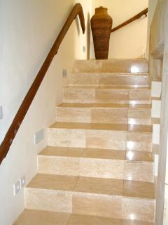 Marble stairs with antique oxen yolk as handrail