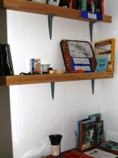 Info Cabinet: Maps, DVDs, Book Exchange, Phone Chargers, Brochures, Sewing Kit, Misc.