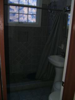 Bathroom looking toward next door.