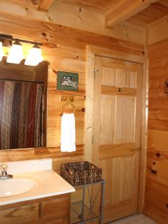Full Bathroom off Bedroom 1 also opens to common area.