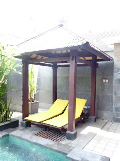 Deck chairs under Bali hut next to pool we have 4 for if needed