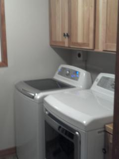 utility room with large capacity washer and dryer