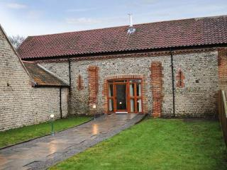 THE PADDOCKS barn conversion, with a woodburner, close to coast in Cromer Ref