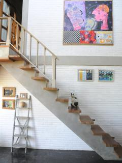 stairs down from the master bedroom to the office/library space