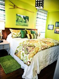 The Green Acres Bedroom with a king size pillow top bed. Premium bedding.