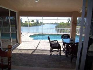 Sunny Haven (former Villa Lucy) - Cape Coral electric heated Pool Home with 3 bedroom/2 bathroom on a wide fresh water canal