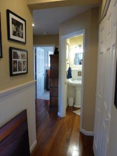 Looking down hallway to 2nd bath and bedroom