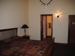 The Dove Room.  Large room with one king bed and a full bath with a deep tub/ shower. Exit to deck.