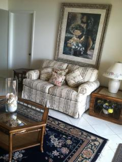 Living Room Love seat with quality art, and filled with Comfort and Style