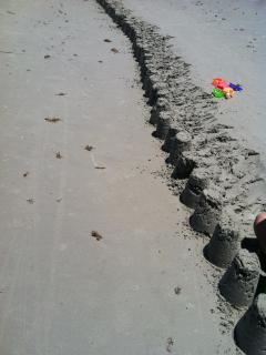 Come on have fun and be a kid again Make a sandcastle write your name in the sand or with  seashells