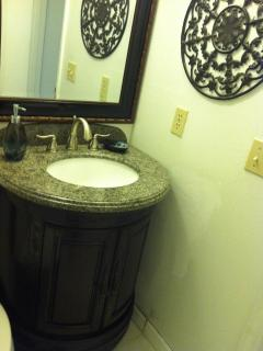 Second full bath with wood and granite