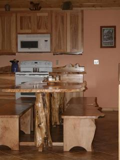 Great room - kitchen w/custom made, 9 ft., live-edge table w/matching benches