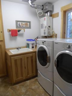 Washer, dryer, laundry room sink and hot water on demand system