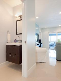 Powder room off the entry way