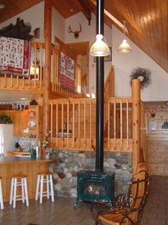 Enjoy the cozy fireplace with local river rock suround.