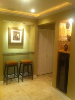Beverage cooler and Breakfast Bar with two stools.