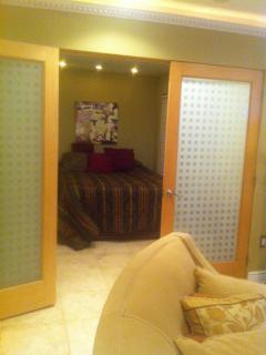 French Doors Open Bedroom to Living Room