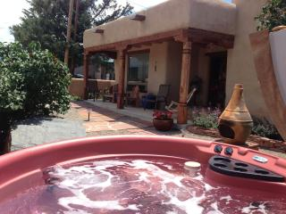 Hot tub (for 6) facing private, enclosed courtyard; views outward to mts.