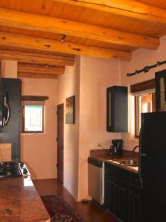 fully equipped kitchen with convection oven/microwave & traditional oven, dishwasher, washer & dryer