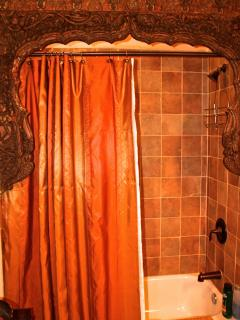 Hall bath with shower and tub (in laid wood features)
