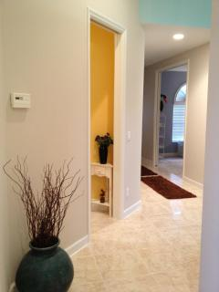 Hallway looking into the half bath and additional guest room with trundle bed.