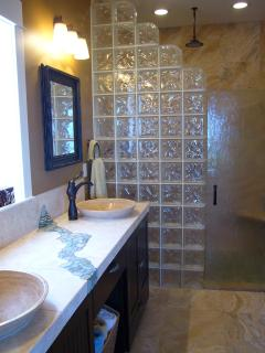Travertine master bath w glass block shower