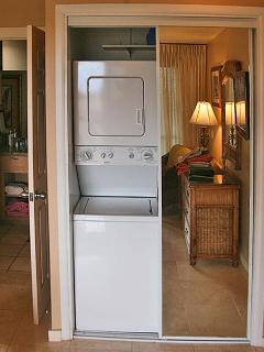Washer & dryer is located in one of the closets in Master bedroom.
