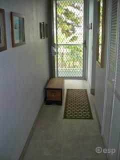 Entry security screen allows silky sea breeze to flow thru condo from the lanai