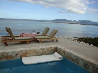 Anguilla Caribbean Villa with private swimming pool. Beachfront, at sea-level, West End Village