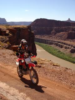 Follow the Colorado River on OHV vehicles and explore the red rock country.