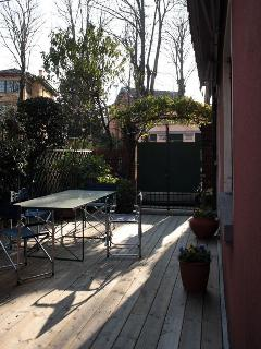 Private garden with outside table and chairs