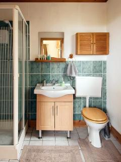 En Suite bathroom with shower, wash basin and toilet