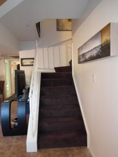 Stairs leading up to master suite