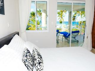 Beach view from our bed (Master Suite)