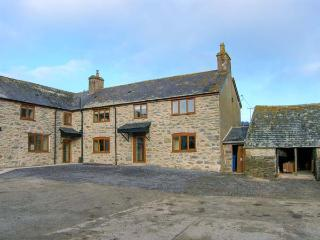 TYDDYN, stone farmhouse, with woodburner, enclosed patio, parking, and games
