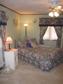 Queen bedroom on main floor next to bathroom