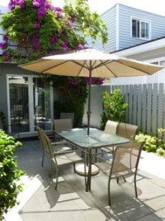 Patio with BBQ and dining table