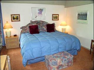 Beautiful master bedroom with king bed, bath, TV/VCR